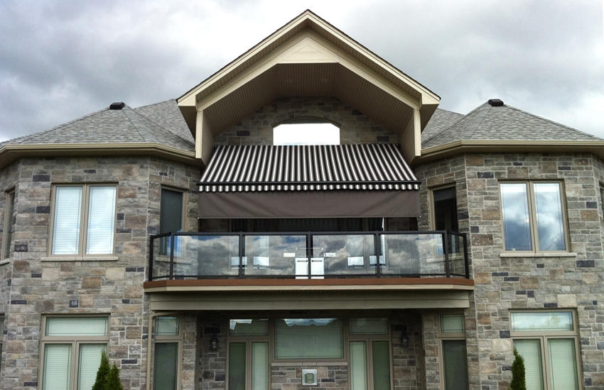 Retractable awning on a balcony of an estate home