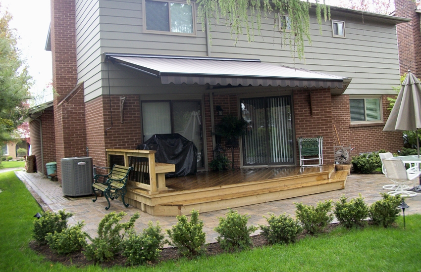 Brown awning installed on siding