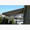 Semi-cassette awning installed under the soffit