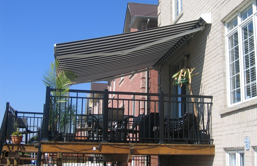 Black and white awning over deck