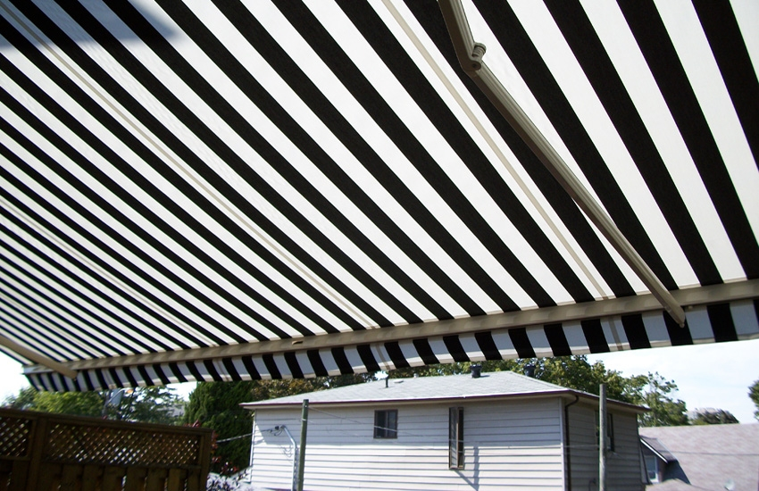Residential striped awning over deck