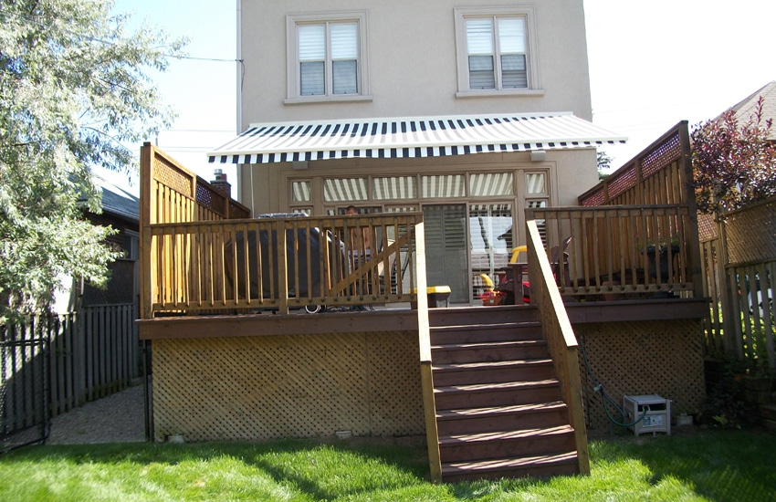 Residential striped awning over deck | Rolltec ...