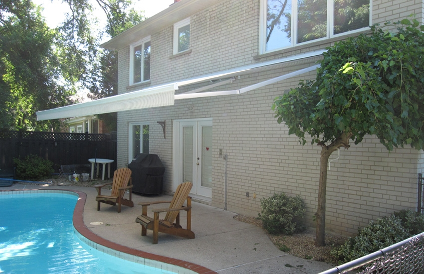 Awning with subtle stripes by the pool