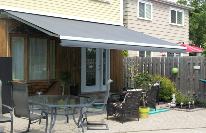 Solid grey awning by the pool side