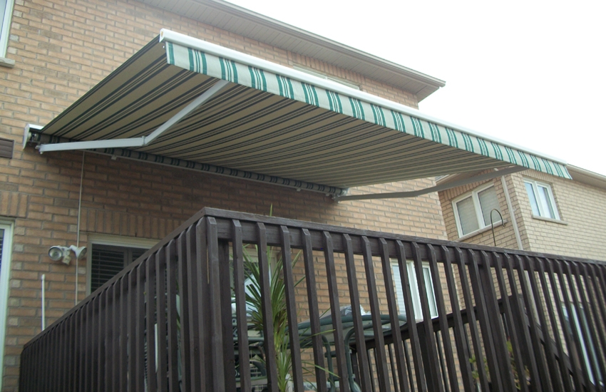 Green striped awning over raised patio