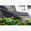 Black and grey retractable awning
