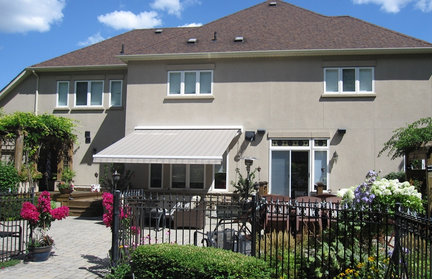 Neutral Awning Against Stucco Wall Rolltec 174 Retractable