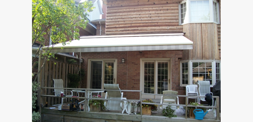 Neutral awning on wooden siding